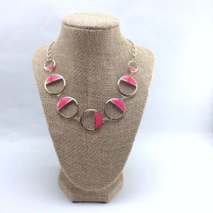 Silver necklace with half filled pink circles